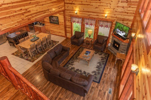 Looking down into the living room at The Pool Palace, a 5 bedroom cabin rental located in Pigeon Forge