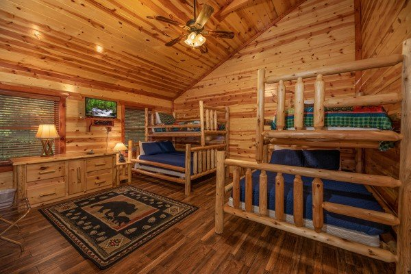 Bunk room at The Pool Palace, a 5 bedroom cabin rental located in Pigeon Forge