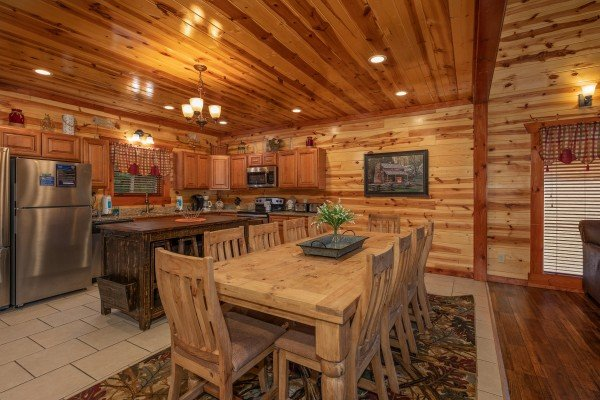 Dining space for 10 and kitchen at The Pool Palace, a 5 bedroom cabin rental located in Pigeon Forge