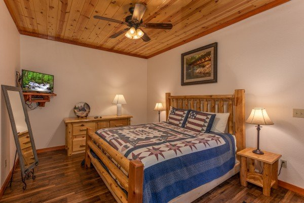 Fourth bedroom with TV and dresser at The Pool Palace, a 5 bedroom cabin rental located in Pigeon Forge