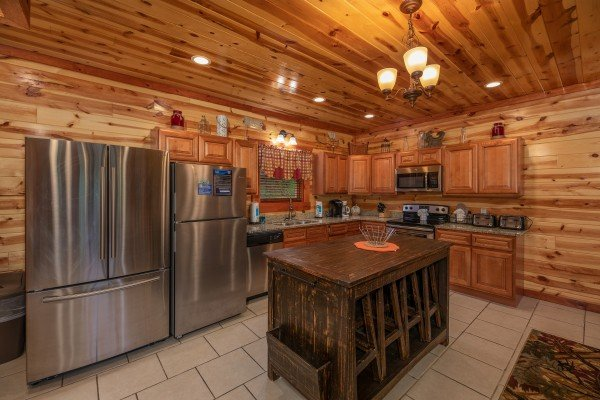 Kitchen with stainless steel appliances and two refrigerators at The Pool Palace, a 5 bedroom cabin rental located in Pigeon Forge
