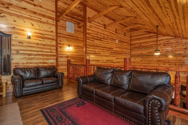 Loft space with seating at The Pool Palace, a 5 bedroom cabin rental located in Pigeon Forge