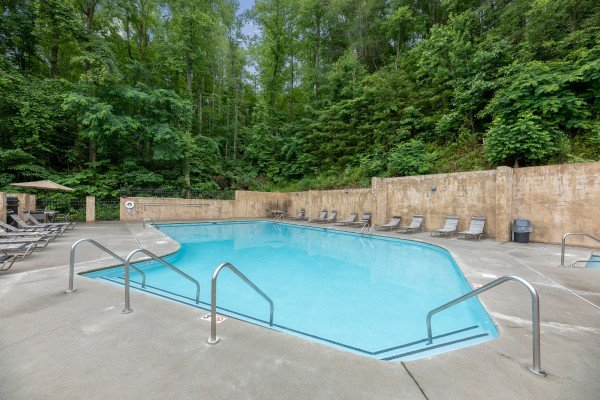 Outdoor pool at Sherwood Forest at The Pool Palace, a 5 bedroom cabin rental located in Pigeon Forge