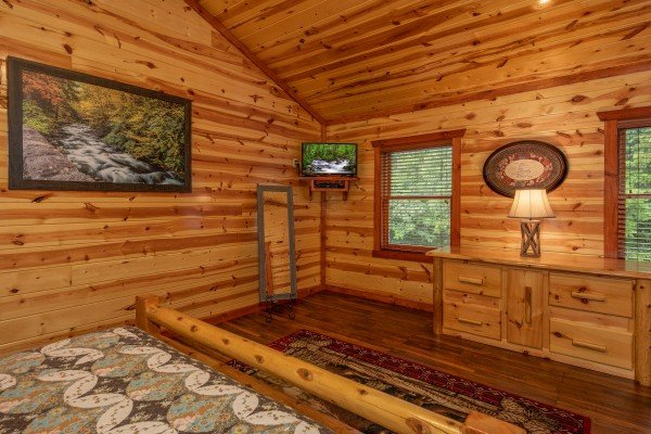 TV with dresser at The Pool Palace, a 5 bedroom cabin rental located in Pigeon Forge