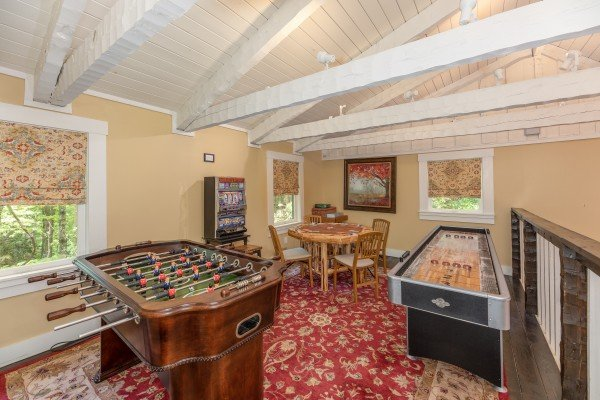 Foosball and shuffleboard at The Lodge at Paradise Falls, a 4 bedroom cabin rental located in Pigeon Forge