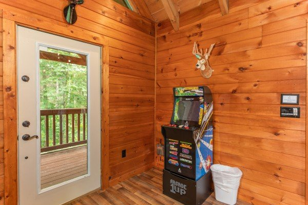 Arcade game at The Lodge at Paradise Falls, a 4 bedroom cabin rental located in Pigeon Forge