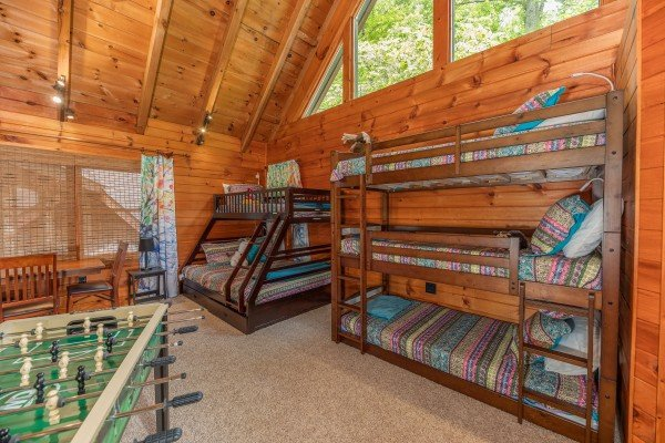 Bunk beds and a foosball table at The Lodge at Paradise Falls, a 4 bedroom cabin rental located in Pigeon Forge