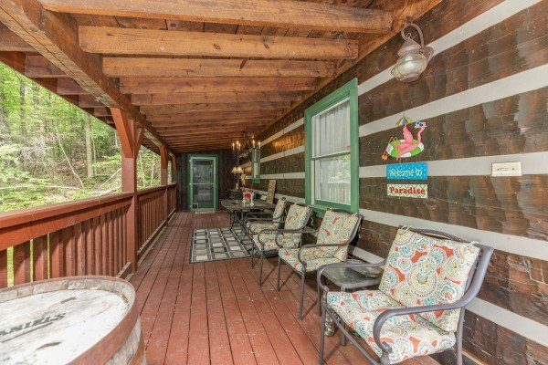 Covered porch with seating at The Lodge at Paradise Falls, a 4 bedroom cabin rental located in Pigeon Forge