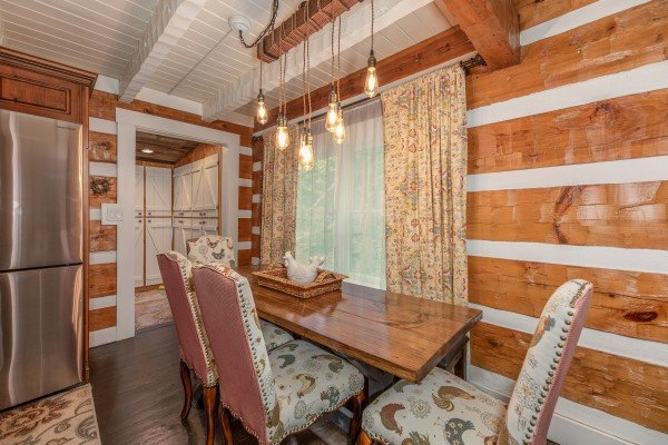 Dining table for four at The Lodge at Paradise Falls, a 4 bedroom cabin rental located in Pigeon Forge