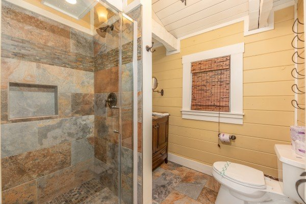 Bathroom with a slate and glass shower at The Lodge at Paradise Falls, a 4 bedroom cabin rental located in Pigeon Forge