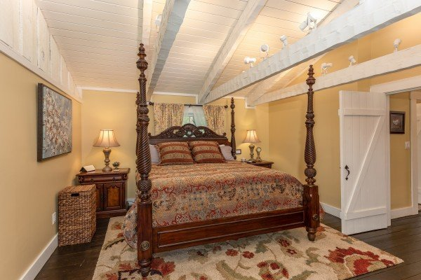 Bedroom with a four post bed at The Lodge at Paradise Falls, a 4 bedroom cabin rental located in Pigeon Forge