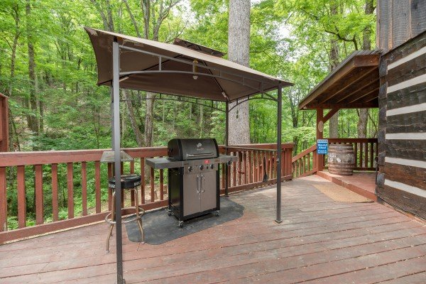 Gas grill under a canopy on the deck at The Lodge at Paradise Falls, a 4 bedroom cabin rental located in Pigeon Forge