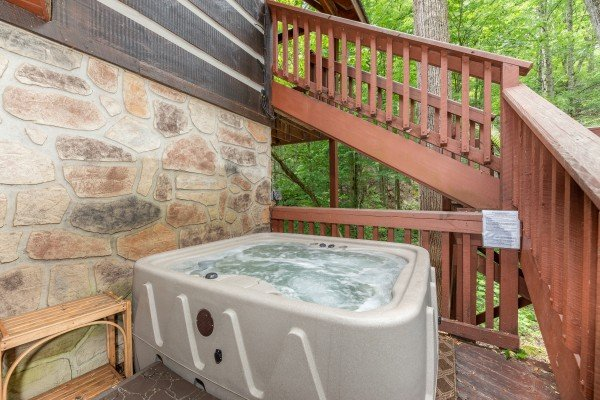 Hot tub on the deck at The Lodge at Paradise Falls, a 4 bedroom cabin rental located in Pigeon Forge