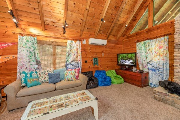Kids room with sleeper sofa, bean bag chairs, and TV at The Lodge at Paradise Falls, a 4 bedroom cabin rental located in Pigeon Forge