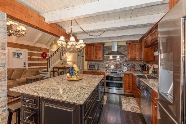 Kitchen with stainless appliances and granite counters at The Lodge at Paradise Falls, a 4 bedroom cabin rental located in Pigeon Forge