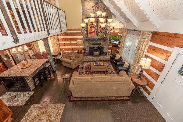 Looking into the living room from the stairs at The Lodge at Paradise Falls, a 4 bedroom cabin rental located in Pigeon Forge