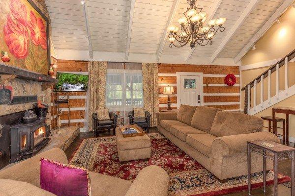 Living room with fireplace and TV at The Lodge at Paradise Falls, a 4 bedroom cabin rental located in Pigeon Forge