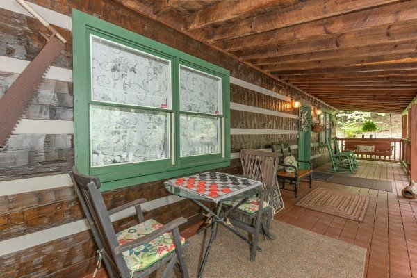 Porch with checker game and swing at The Lodge at Paradise Falls, a 4 bedroom cabin rental located in Pigeon Forge