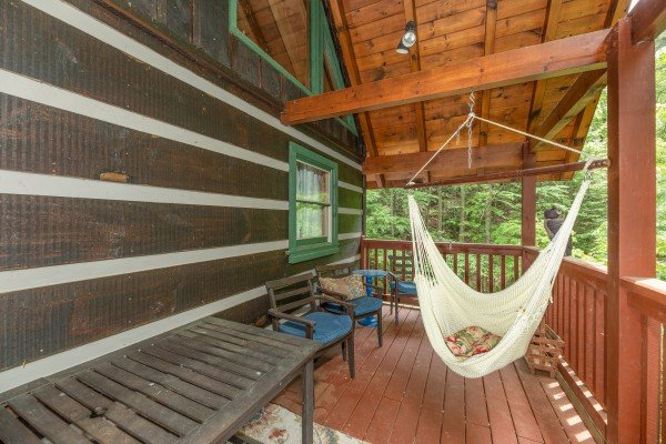 Porch with hammock at The Lodge at Paradise Falls, a 4 bedroom cabin rental located in Pigeon Forge