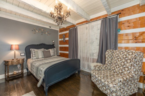 Bedroom with a blue bed at The Lodge at Paradise Falls, a 4 bedroom cabin rental located in Pigeon Forge