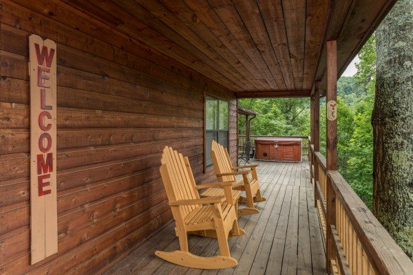 Rocking chairs on the covered deck at Peace & Quiet, a 3 bedroom cabin rental located in Pigeon Forge