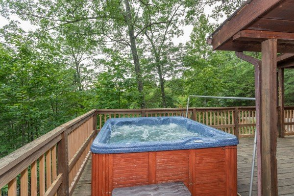 Hot tub on the deck at Peace & Quiet, a 3 bedroom cabin rental located in Pigeon Forge