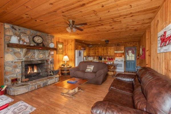 Living room with fireplace at Peace & Quiet, a 3 bedroom cabin rental located in Pigeon Forge
