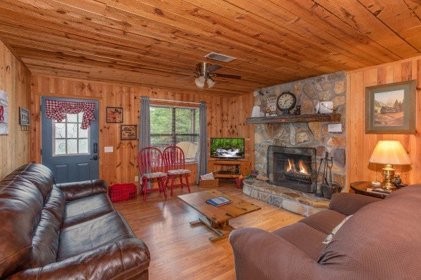 TV and fireplace in the living room at Peace & Quiet, a 3 bedroom cabin rental located in Pigeon Forge