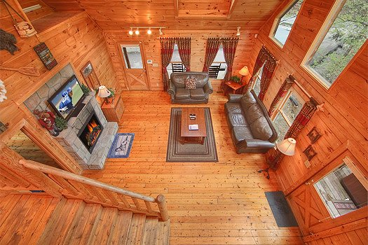 Looking down into the living room at Trapper's Trace, a 2 bedroom cabin rental located in Gatlinburg