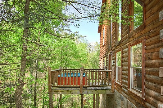 Back deck with hot tub at Trapper's Trace, a 2 bedroom cabin rental located in Gatlinburg