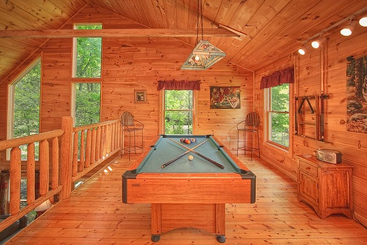 Lofted game room with pool table at Trapper's Trace, a 2 bedroom cabin rental located in Gatlinburg