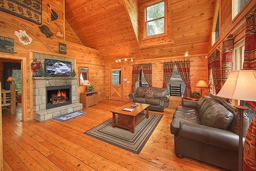 living room with fireplace at trapper's trace a 2 bedroom cabin rental located in gatlinburg