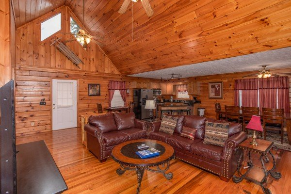 Living room with a sofa and loveseat at Burrow Inn, a 4-bedroom cabin rental located in Pigeon Forge