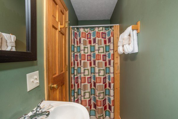 Bathroom with a walk in shower at Burrow Inn, a 4-bedroom cabin rental located in Pigeon Forge