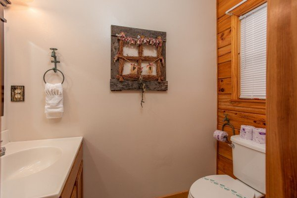 Bathroom at Burrow Inn, a 4-bedroom cabin rental located in Pigeon Forge