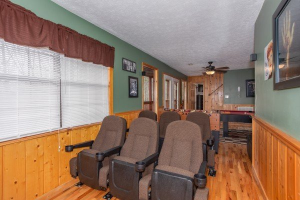 Theater seating for six, looking into the game room at Burrow Inn, a 4-bedroom cabin rental located in Pigeon Forge