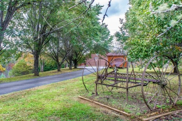 Old farm equipment at Leconte Nirvana, a 3 bedroom cabin rental located in Pigeon Forge