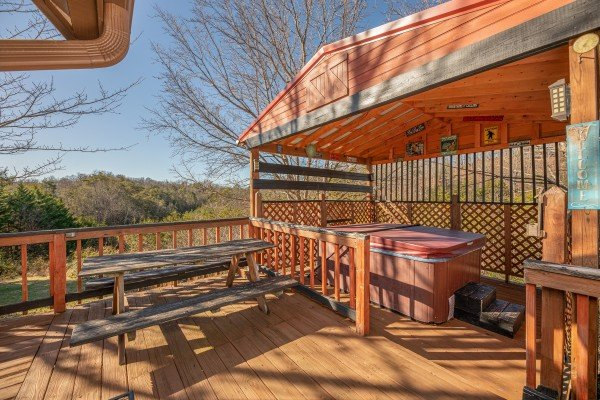 Hot tub under a roof on the deck at Leconte Nirvana, a 3 bedroom cabin rental located in Pigeon Forge
