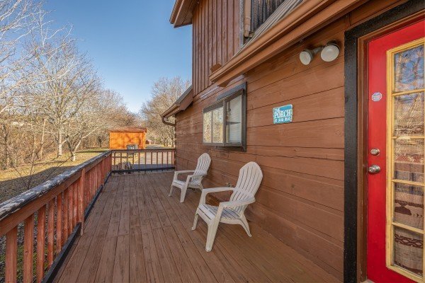 Adirondack chairs on a deck at Leconte Nirvana, a 3 bedroom cabin rental located in Pigeon Forge