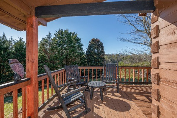 Deck furniture and a ridge view at Leconte Nirvana, a 3 bedroom cabin rental located in Pigeon Forge