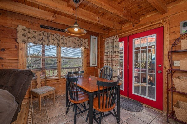 Dining space for four at Leconte Nirvana, a 3 bedroom cabin rental located in Pigeon Forge