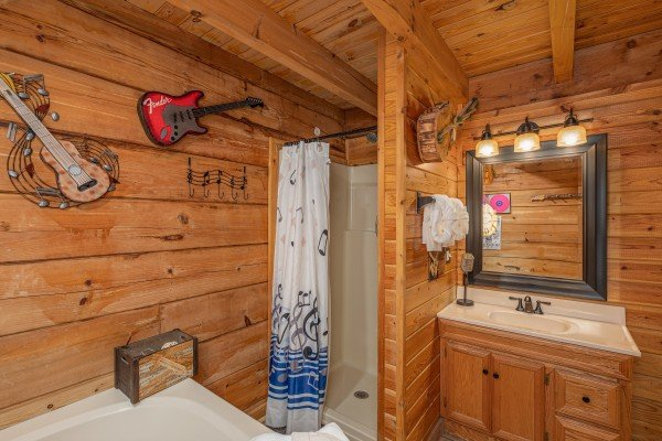 Bathroom with jacuzzi and separate shower at Leconte Nirvana, a 3 bedroom cabin rental located in Pigeon Forge