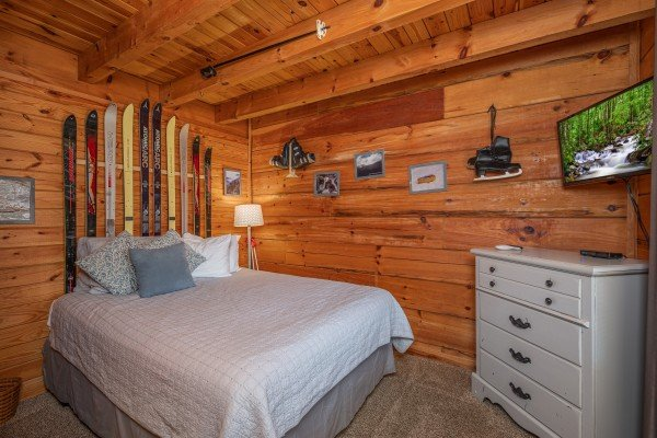 Bedroom with dresser and TV at Leconte Nirvana, a 3 bedroom cabin rental located in Pigeon Forge