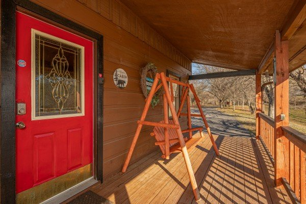 Front porch with a swing at Leconte Nirvana, a 3 bedroom cabin rental located in Pigeon Forge