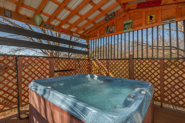 Hot tub under a covered deck at Leconte Nirvana, a 3 bedroom cabin rental located in Pigeon Forge