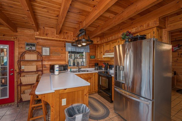 Kitchen with stainless and appliances at Leconte Nirvana, a 3 bedroom cabin rental located in Pigeon Forge