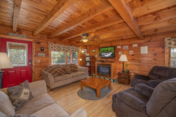 Living room with fireplace, TV, and lots of seating at Leconte Nirvana, a 3 bedroom cabin rental located in Pigeon Forge
