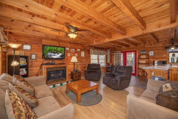 Fireplace and TV in the living room at Leconte Nirvana, a 3 bedroom cabin rental located in Pigeon Forge