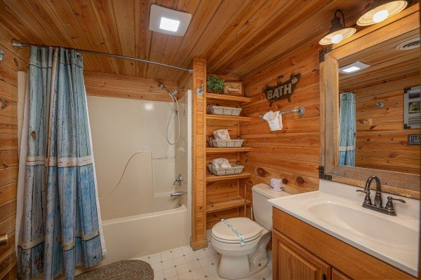 Bathroom with tub and shower at Leconte Nirvana, a 3 bedroom cabin rental located in Pigeon Forge