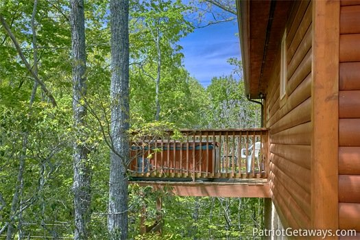 Side view of the deck at Quality Time, a 1 bedroom cabin rental located in Gatlinburg